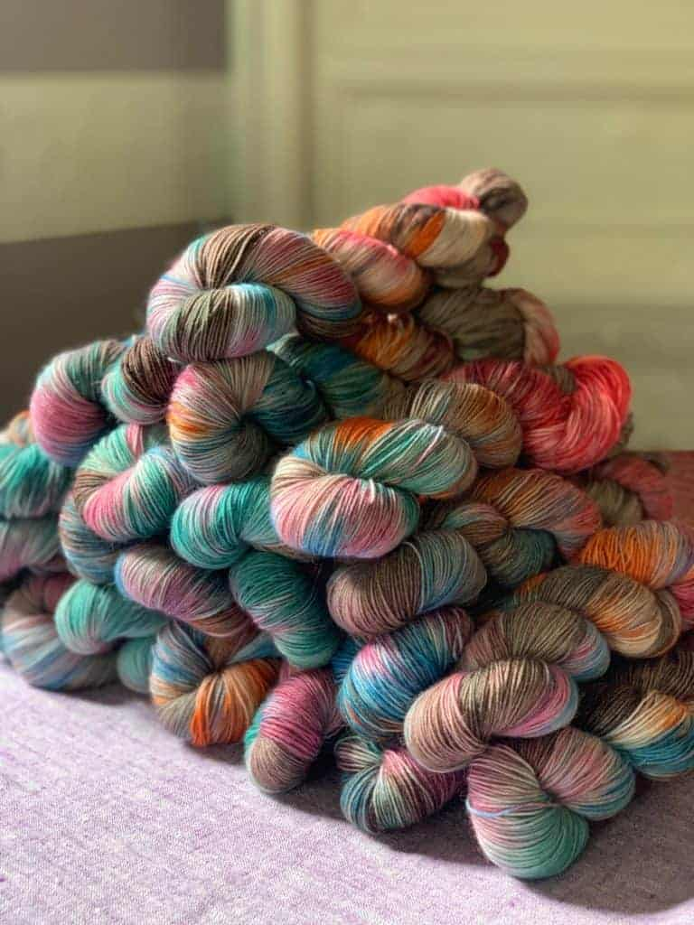 Multicolored yarn in a large pyramid.