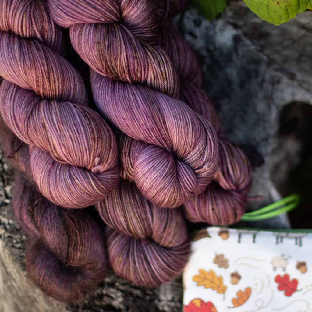 Skeins of purple hand-dyed yarn