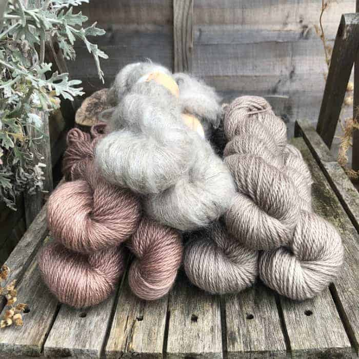 Skeins of purple and grey yarn.