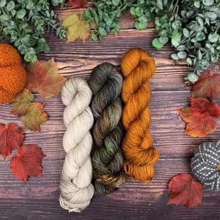White, green and orange yarn.