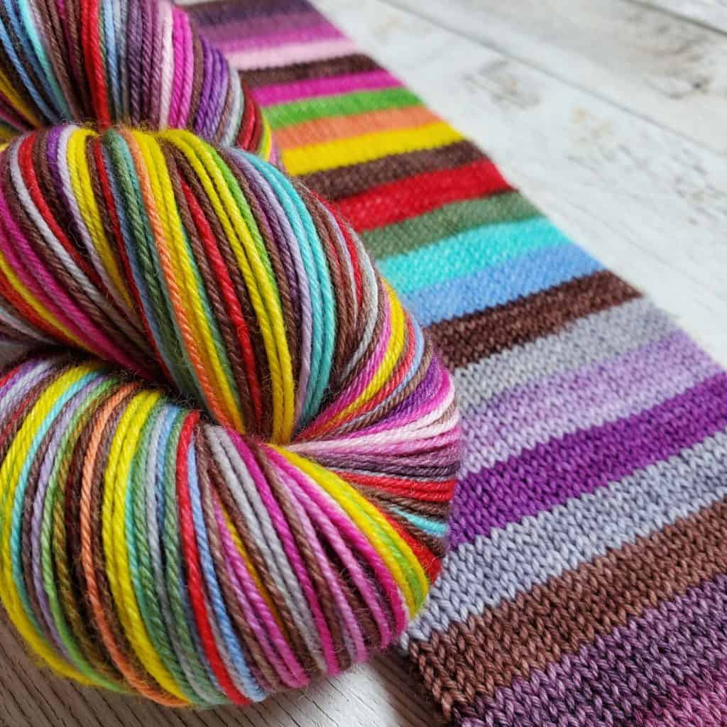 Yarn with red, yellow, blue, purple, gray and brown stripes.