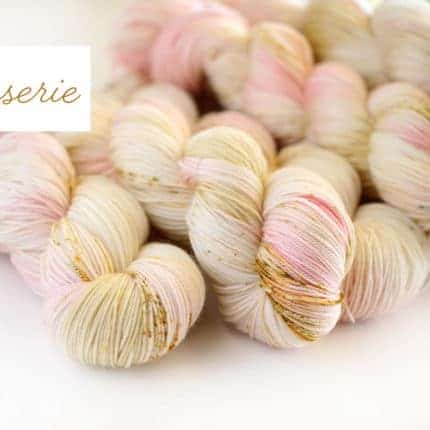 Pink and gold yarn with the word Patisserie.