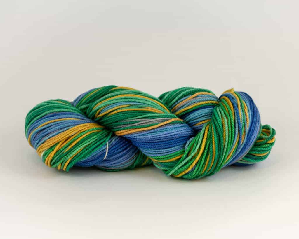 Green, blue and gold self-striping yarn.