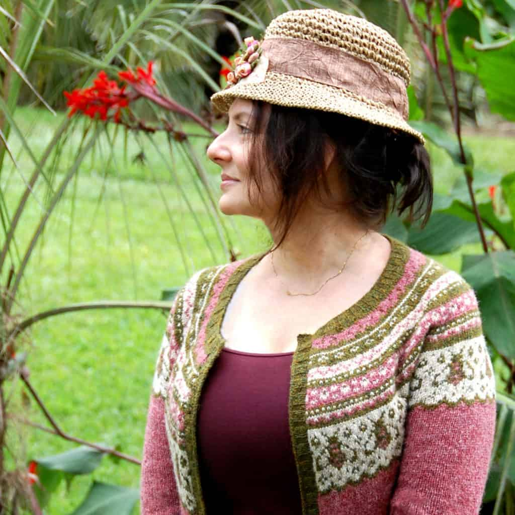 A pink colorwork yoke cardigan.