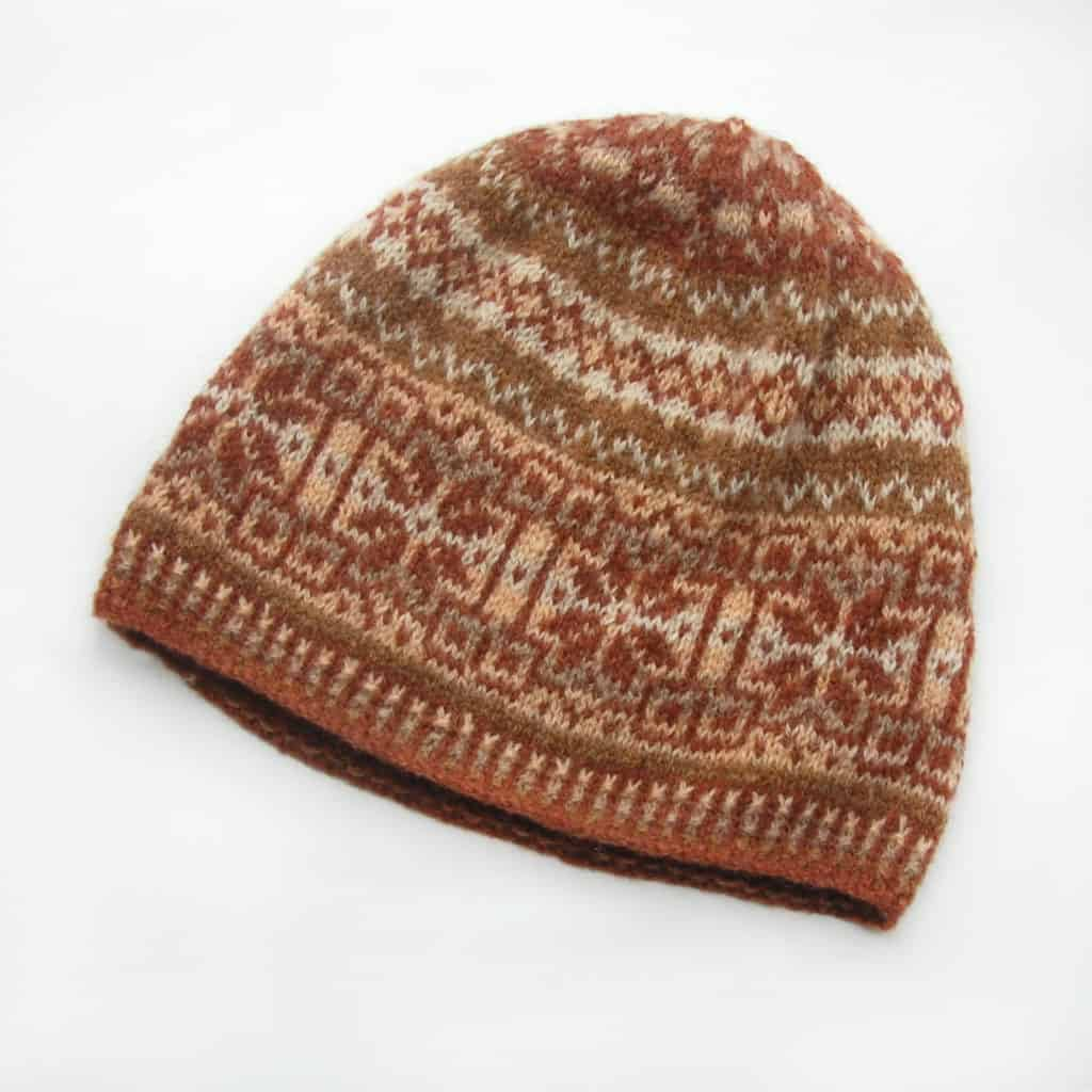 A maroon and taupe colorwork beanie.