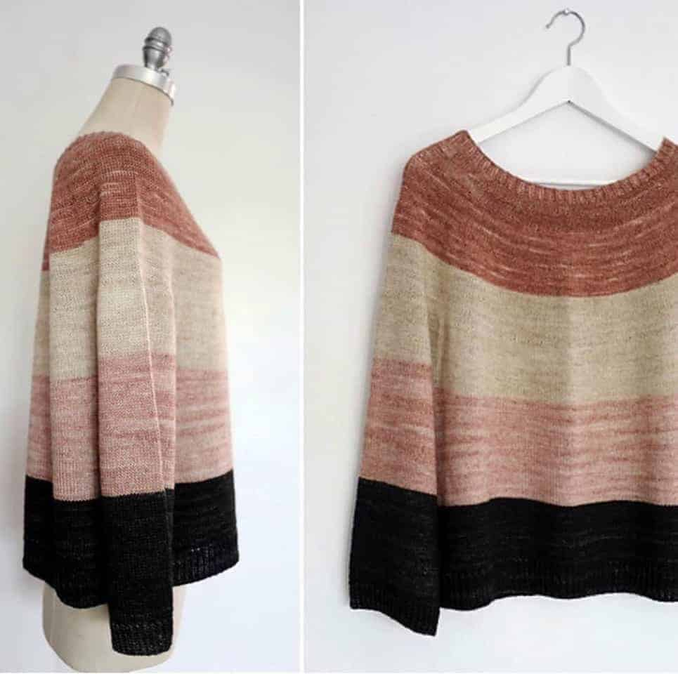 A sweater with wide orange, cream, pink and black stripes.