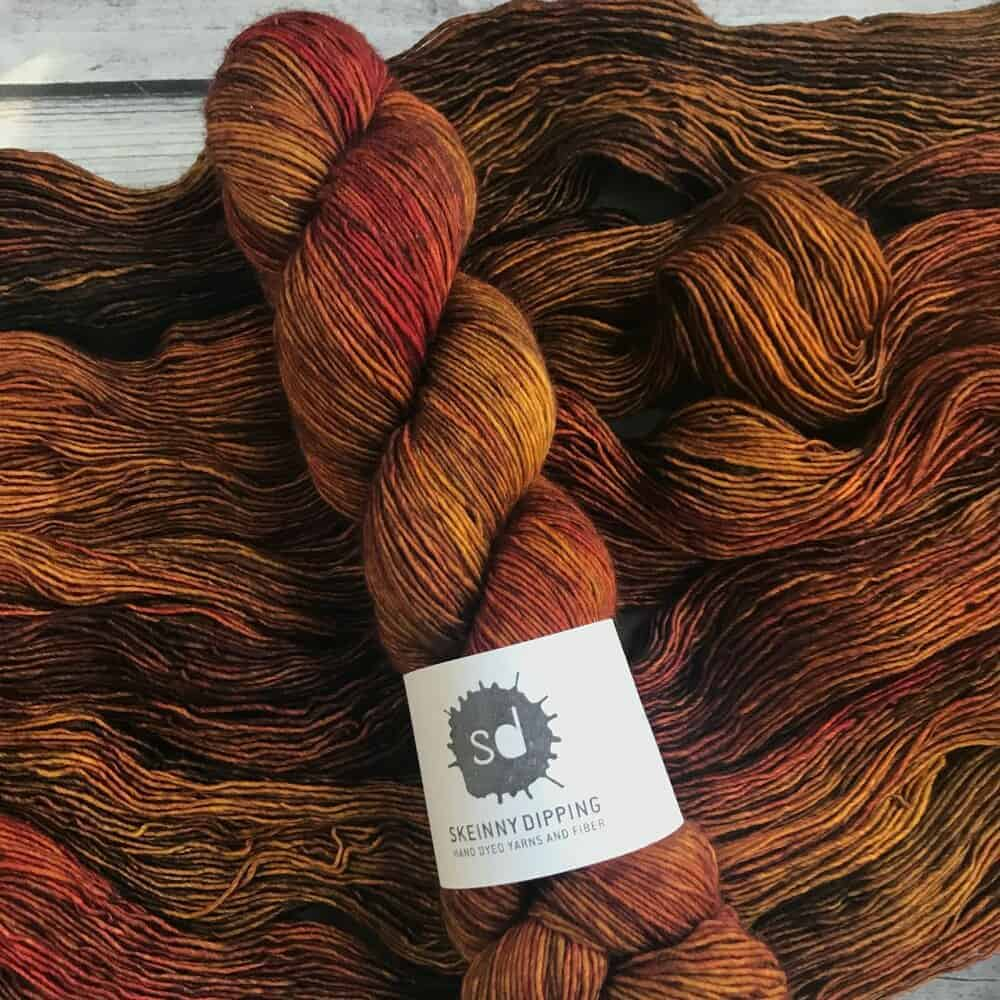 Brown and orange single-ply yarn.