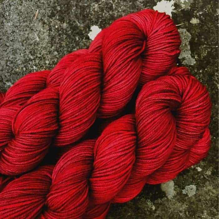 Skeins of red yarn.