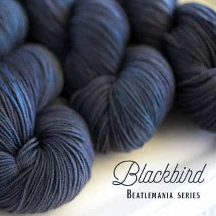 Dark blue yarn with the words Blackbird Beatlemania Series.