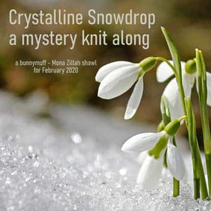A white flower in snow for the Crystalline Snowdrop mystery knit along