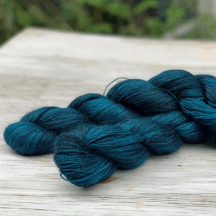 Fuzzy teal yarn.