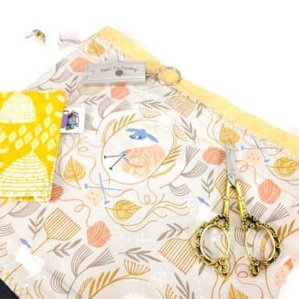A bag in yellow and orange floral fabric.
