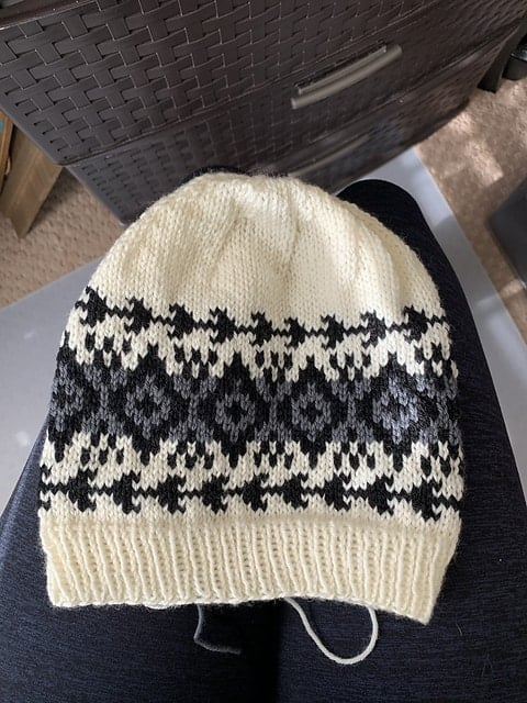 A cream, blue and gray colorwork hat.