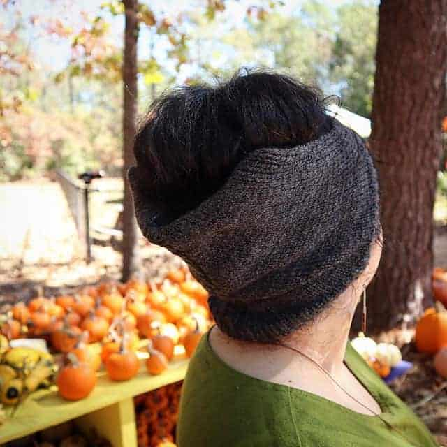 A gray kerchief-style hat.