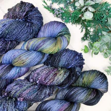 Skeins of blue, purple and yellow yarn.