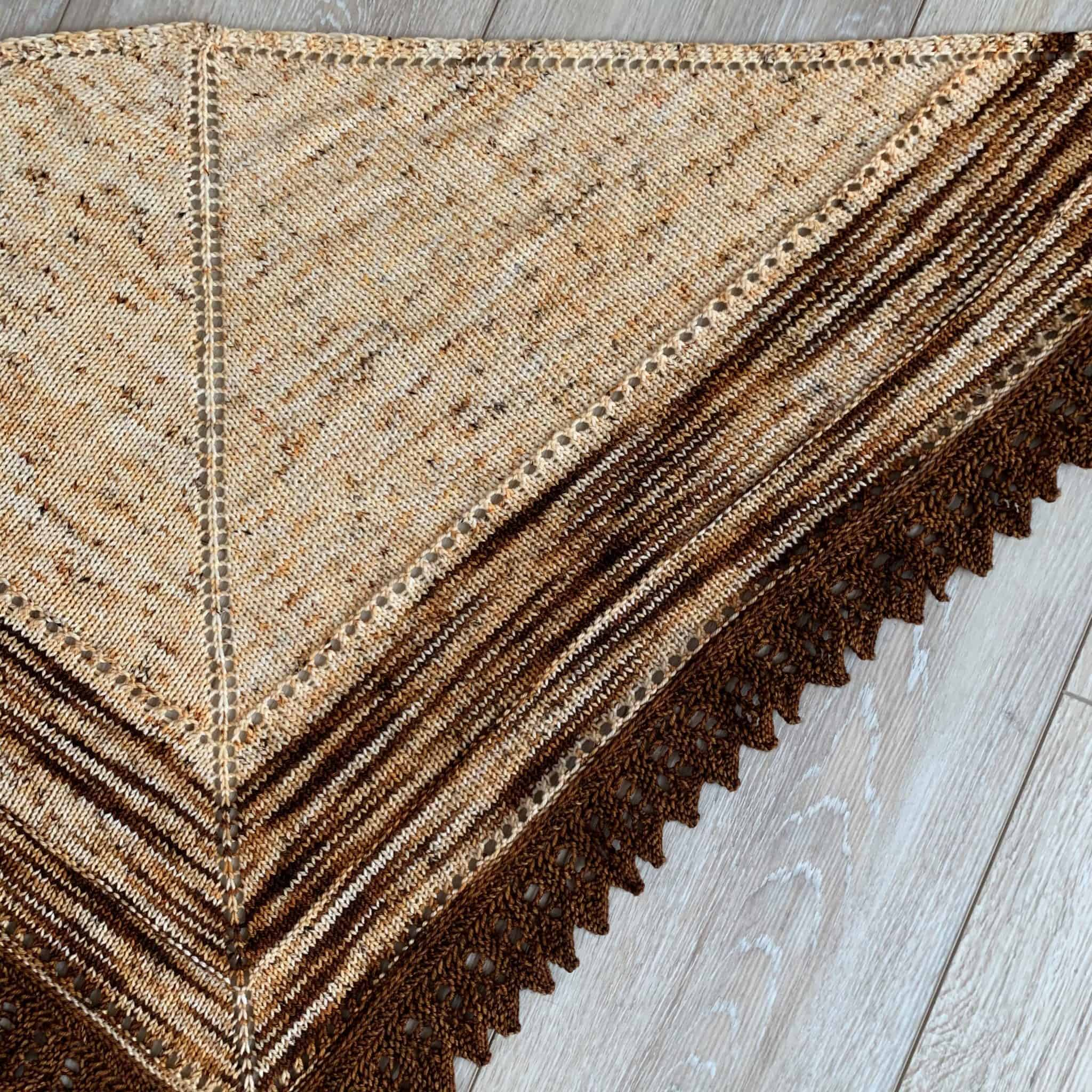 A cream and brown shawl.