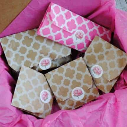 Packages wrapped in pink and kraft tissue paper.