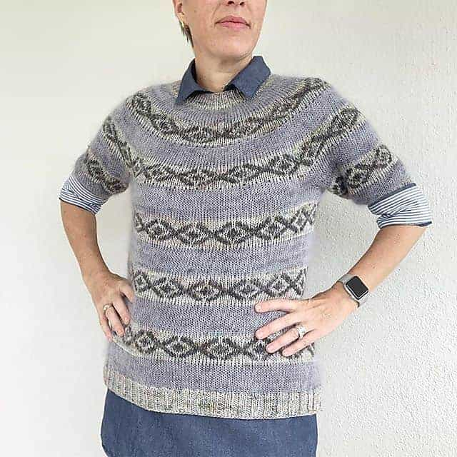 A gray and green colorwork sweater.