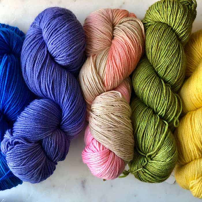 Purple, pink, green and yellow yarn.