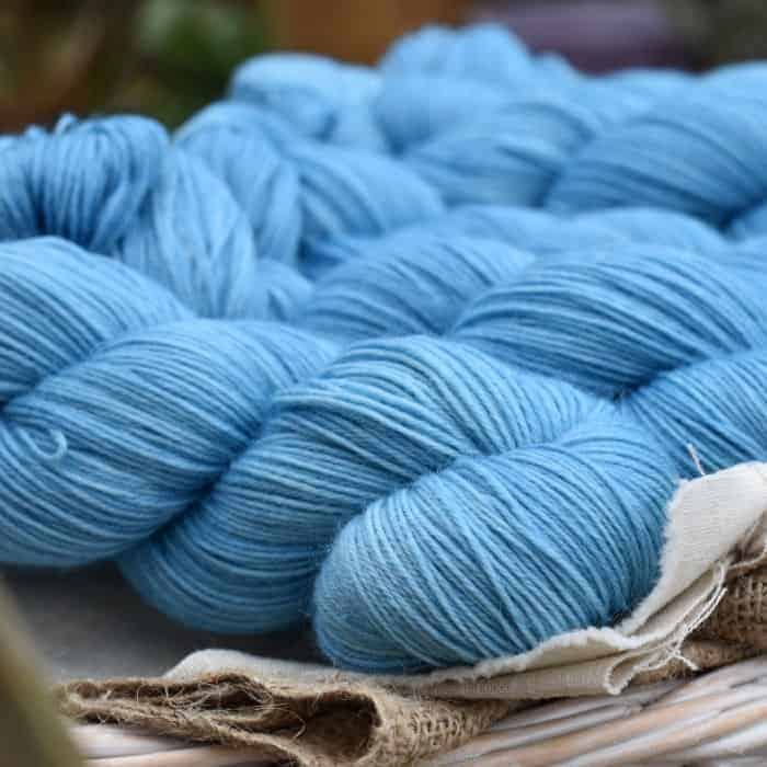 Skeins of sky blue yarn.