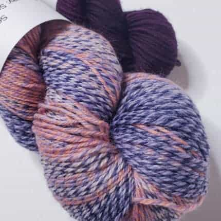 Handspun look yarn with shades of purple.