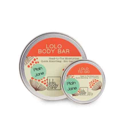 Tins of body butter with orange and aqua accents.