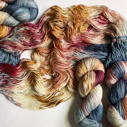 Purple, teal and gold yarn.