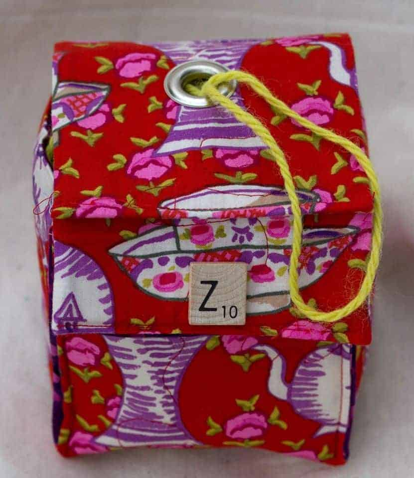 A red and purple bag with a Z Scrabble tile.