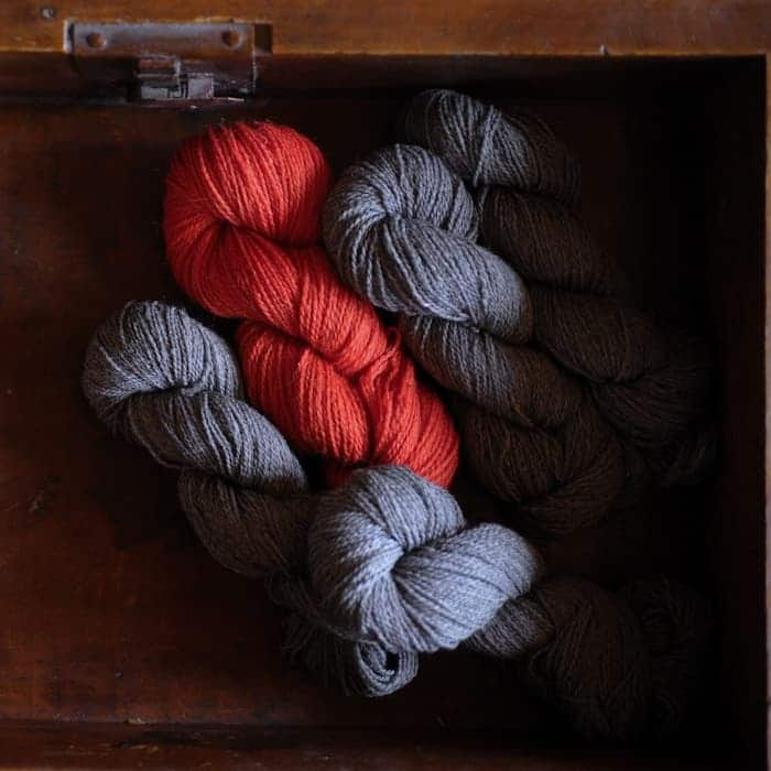 Gray and red yarn.