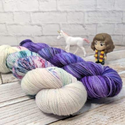 Purple and speckled yarn.