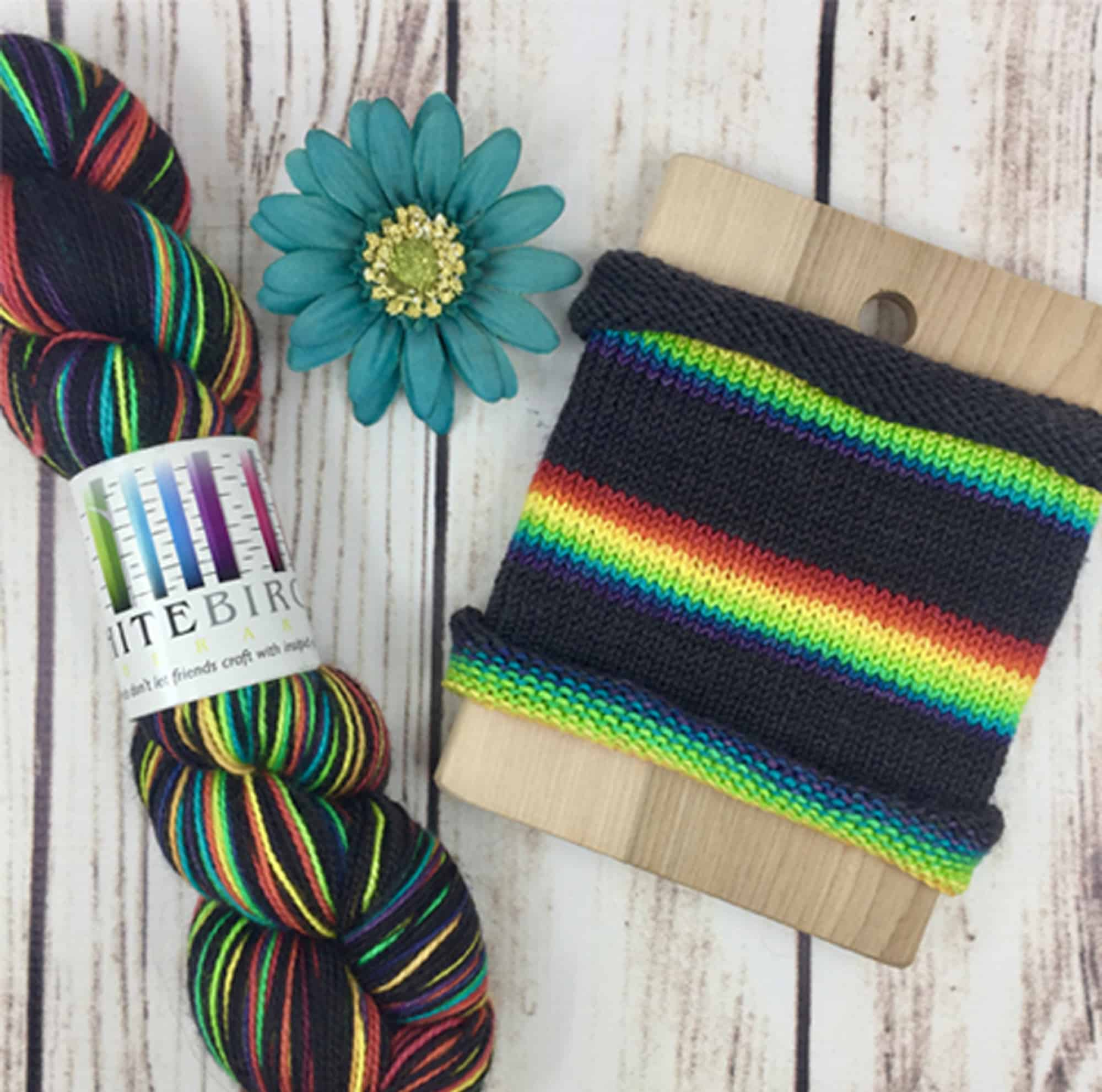 Black yarn with a rainbow..