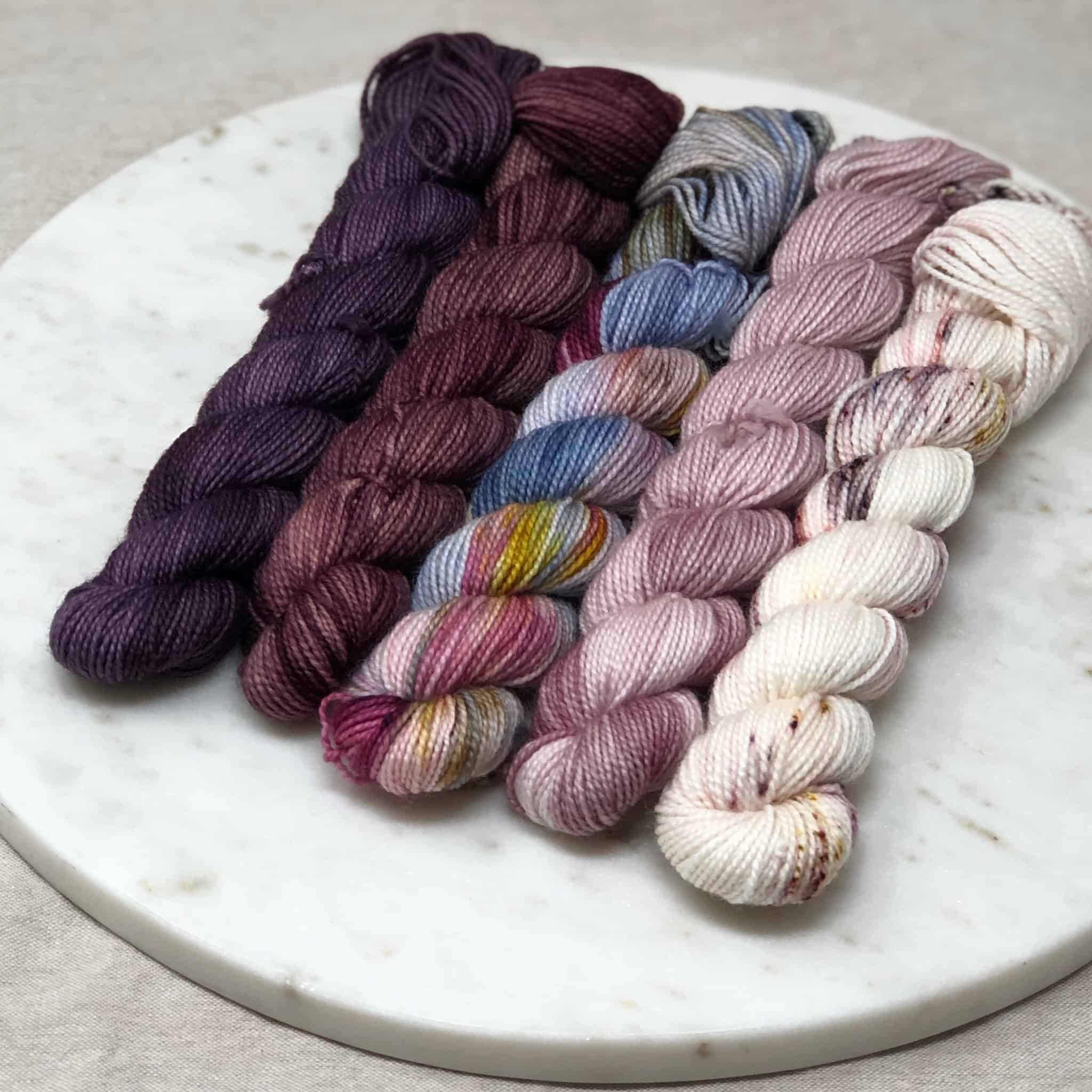 Purple and pink mini skeins.