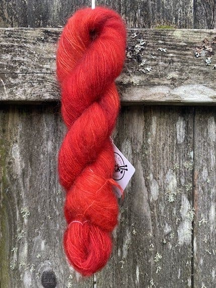 A skein of red mohair yarn.