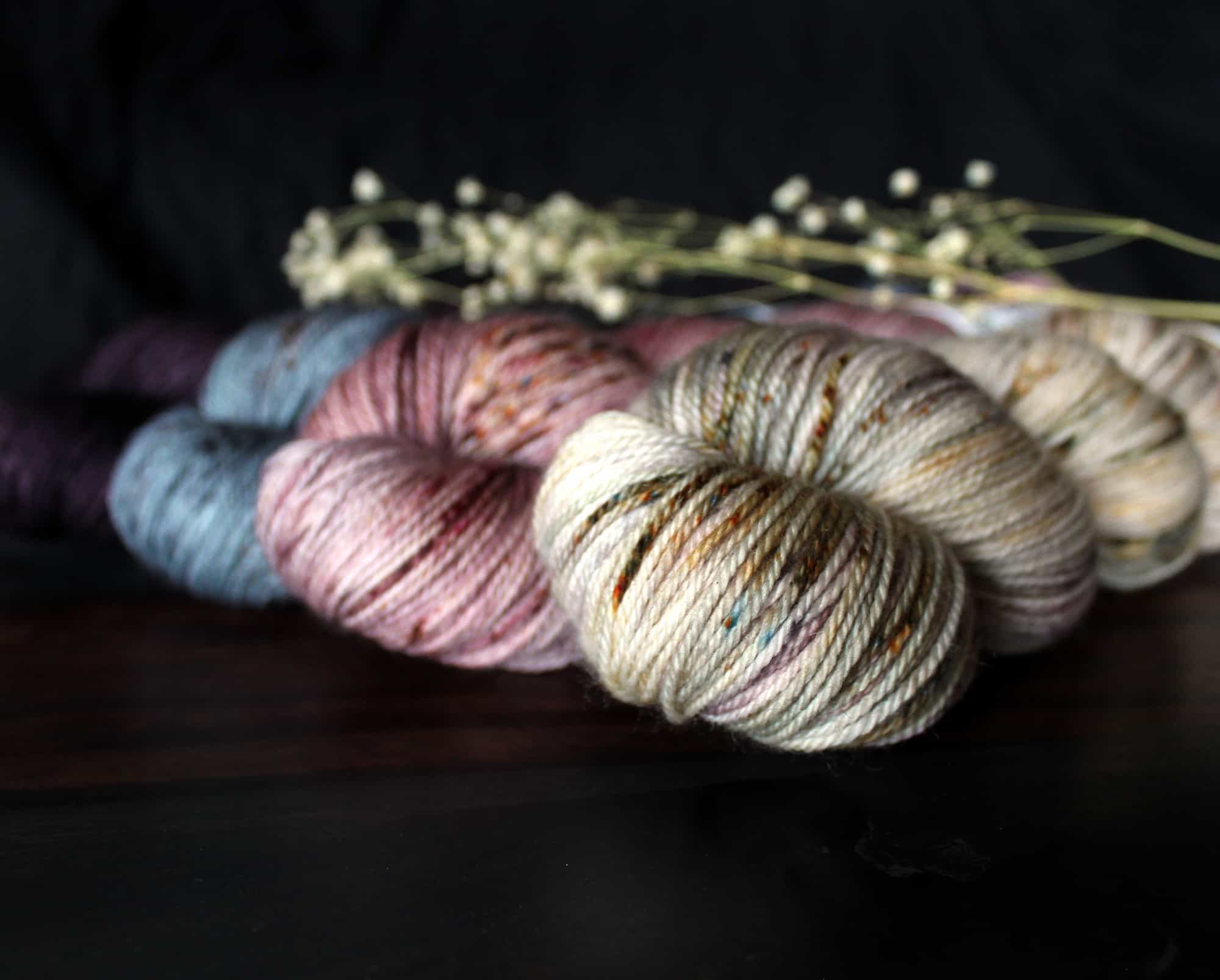 Blue, pink and gray speckled yarn.