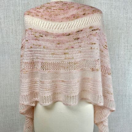 A lacy shawl in pale pink.