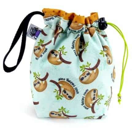 An aqua drawstring bag with cartoon sloths.
