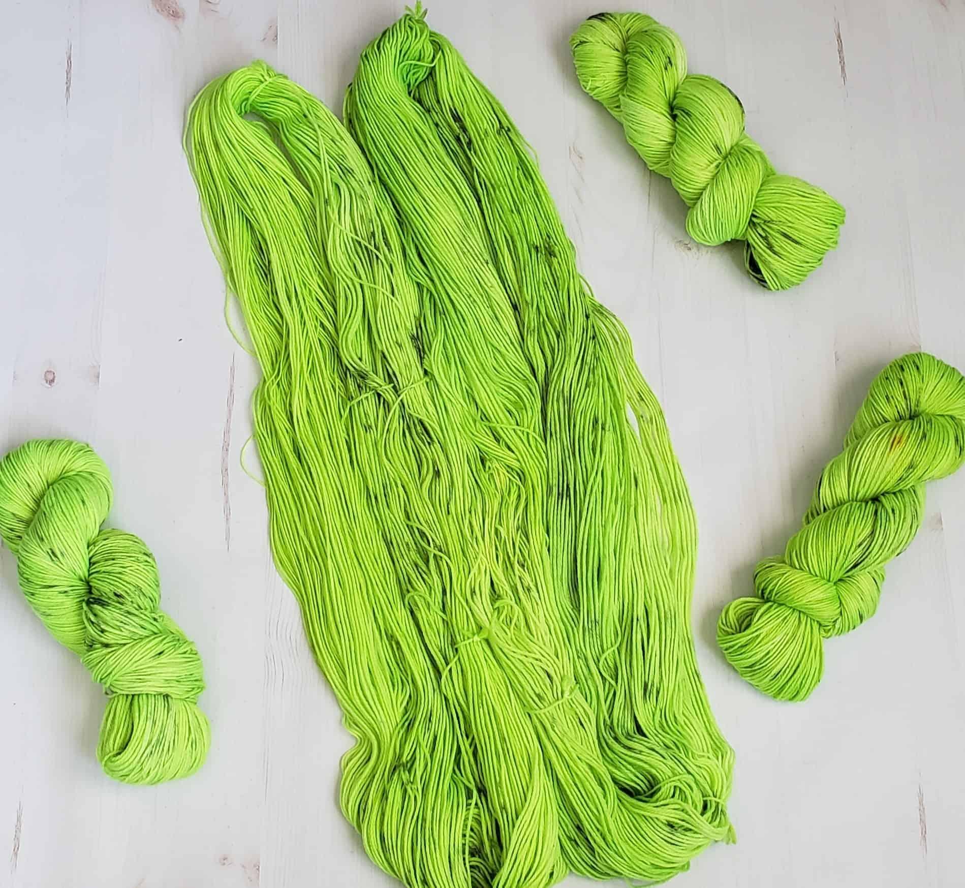 Untwisted skeins of neon green yarn.