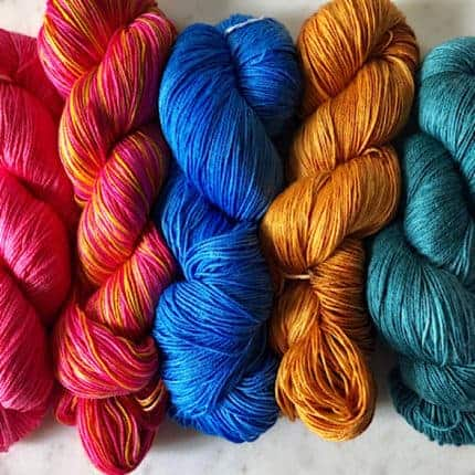 Pink, blue, gold and teal silky yarn.