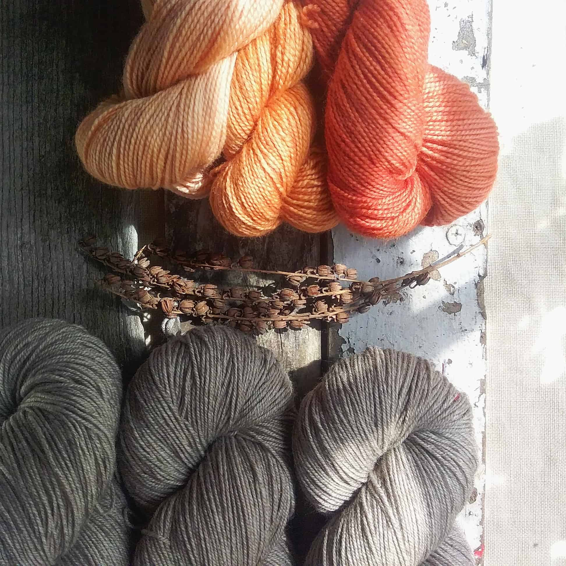 Trios of peachy orange and gray yarn.