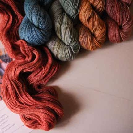 Red, blue, green and orange yarn.