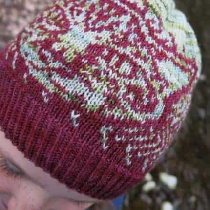 A pink and white colorwork hat.