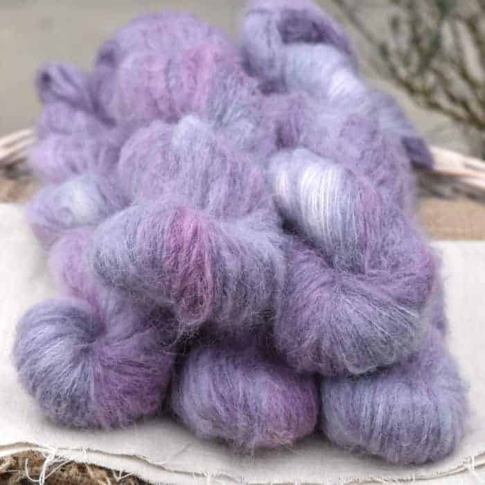 Pale purple fluffy yarn.
