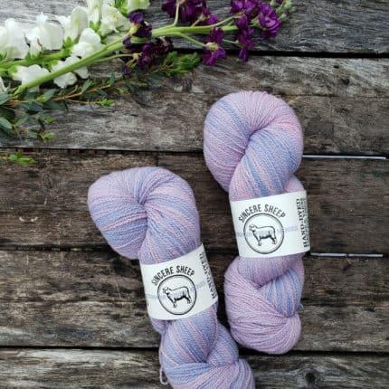 Skeins of pale purple yarn.