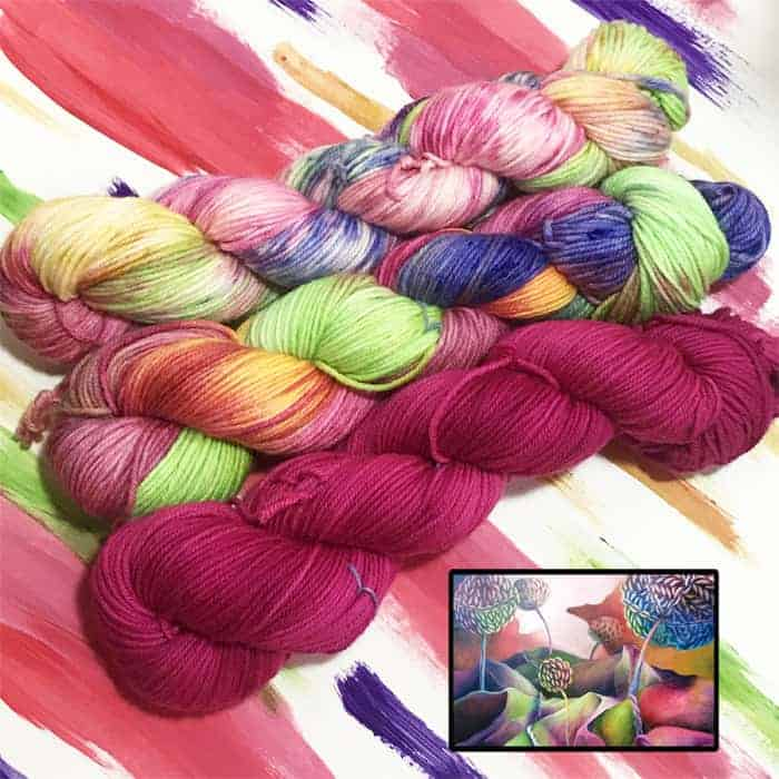 Dark pink, green, blue and orange yarn above a painting with the same hues.