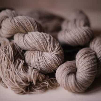 Skeins of taupe yarn.