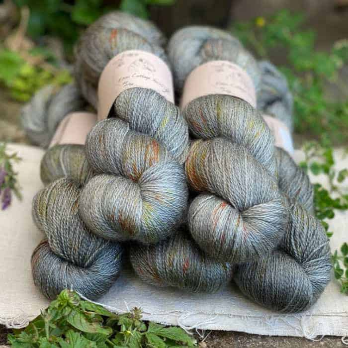 Skeins of sage speckled yarn.