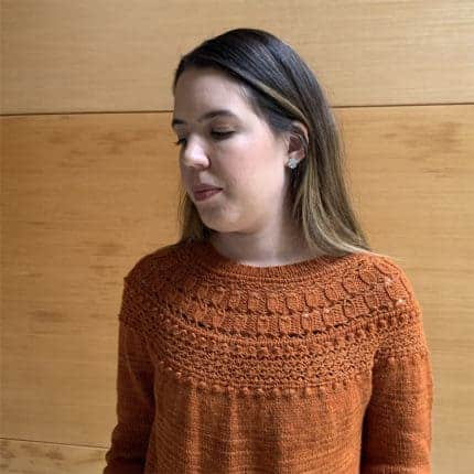 An orange-gold sweater with a lacy yoke.