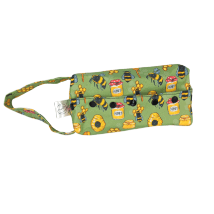 A green box bag with pictures of honey.