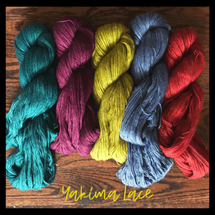 Teal, pink, chartreuse, blue and red yarn and the words Yakima Lace.