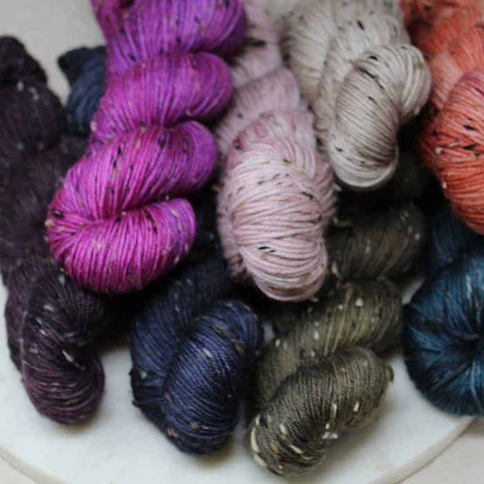 Skeins of bright colored tweed yarn.